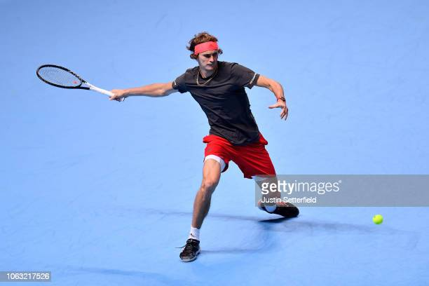 Alexander Zverev of Germany plays a forehand during the singles final against Novak Djokovic of Serbia during Day Eight of the Nitto ATP Finals at...