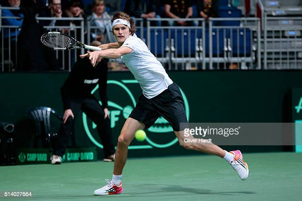 Alexander Zverev of Germany plays a forehand in his match against Lukas Rosol of Czech Republic during Day 3 of the Davis Cup World Group first round...