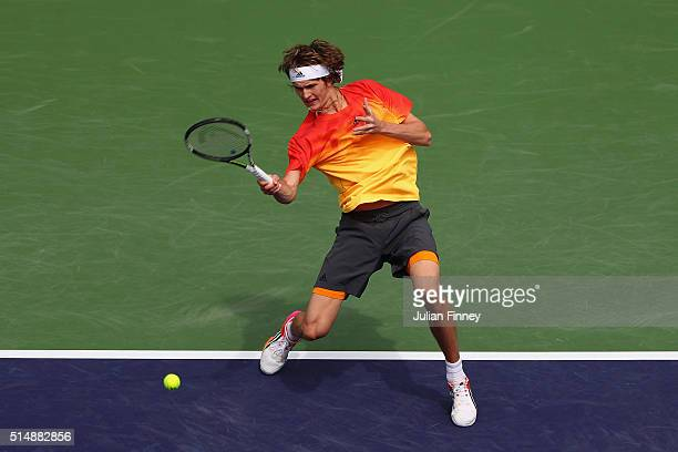 Alexander Zverev of Germany plays a shot in his match against Ivan Dodig of Croatia during day five of the BNP Paribas Open at Indian Wells Tennis...