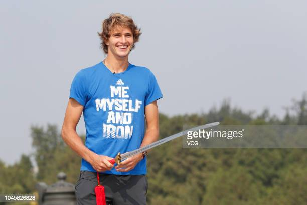 Alexander Zverev of Germany plays Tai Chi as he visits the Temple of the Earth ahead of the 2018 China Open on September 28 2018 in Beijing China