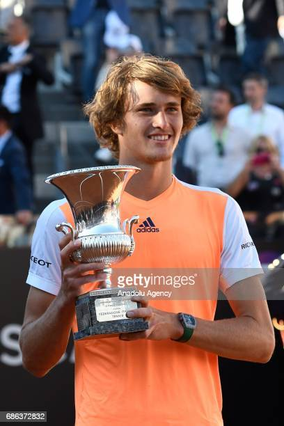 Alexander Zverev of Germany poses for a photo with his trophy after winning the Men's Single Final match against Novak Djokovic of Serbia during day...