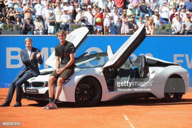 Alexander Zverev of Germany poses with Oliver Zipse member of the BMW Board next to the winners car a BMW i8 Roadster after winning his finalmatch...