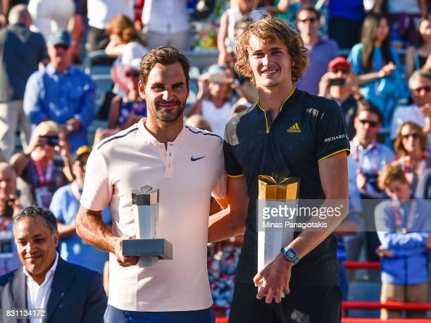 Alexander Zverev of Germany poses with Roger Federer of Switzerland after defeating him 63 64 in the final during day ten of the Rogers Cup presented...