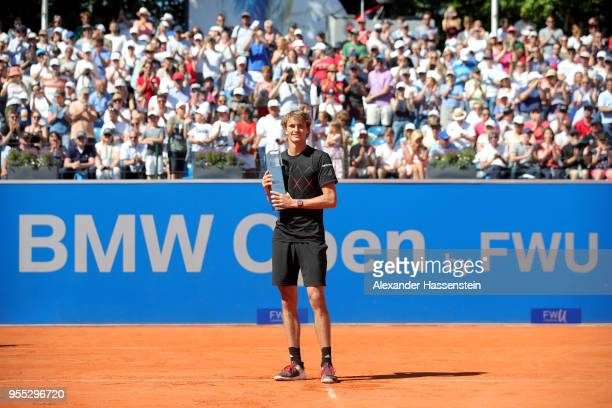 Alexander Zverev of Germany poses with the winners trophy after winning his finalmatch against Philipp Kohlschreiber of Germany on day 9 of the BMW...