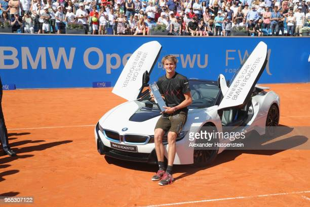 Alexander Zverev of Germany poses with the winners trophy and the winners car a BMW i8 Roadster after winning his finalmatch against Philipp...