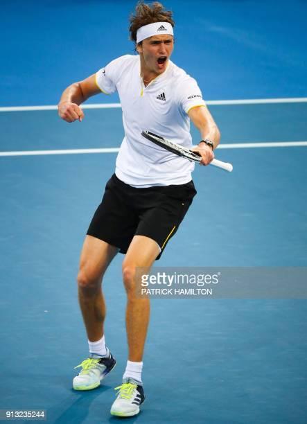 Alexander Zverev of Germany reacts after a point against Alex De Minaur of Australia during their men's singles tennis match in the Davis Cup World...