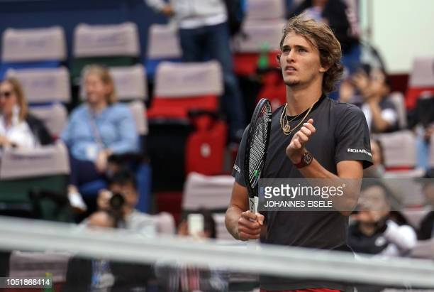 Alexander Zverev of Germany reacts after defeating Alex de Minaur of Australia during their men's singles third round match at the Shanghai Masters...
