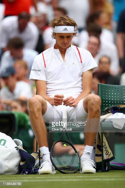Alexander Zverev of Germany reacts as he sits down between games in his Men's Singles first round match against Jiri Vesely of Czech Republic during...