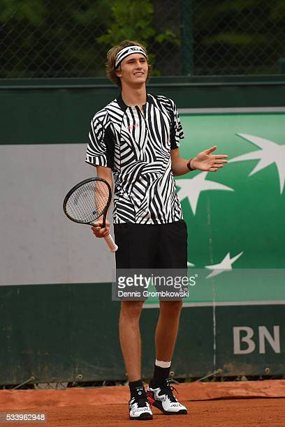 Alexander Zverev of Germany reacts during the Men's Singles first round match against PierreHughes Herbert of France on day three of the 2016 French...