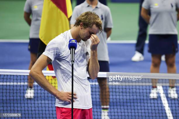 Alexander Zverev of Germany reacts during the trophy presentation after losing his Men's Singles final match against and Dominic Thiem of Austria on...