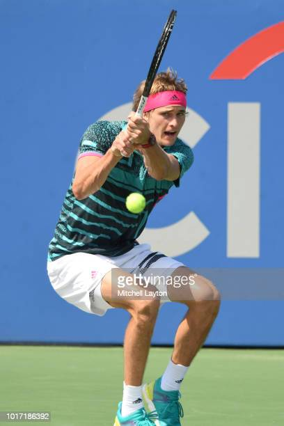 Alexander Zverev of Germany returns a backhand shot to Alex De Minaur of Australia during the Men's Finals on Day Nine of the Citi Open at the Rock...