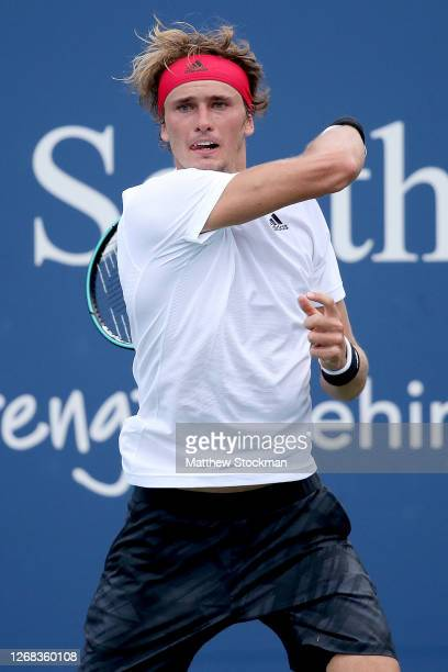 Alexander Zverev of Germany returns a shot to Andy Murray of Great Britain during the Western & Southern Open at the USTA Billie Jean King National...