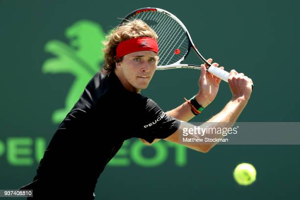 Alexander Zverev of Germany returns a shot to Daniil Medvedev of Russia during the Miami Open Presented by Itau at Crandon Park Tennis Center on...