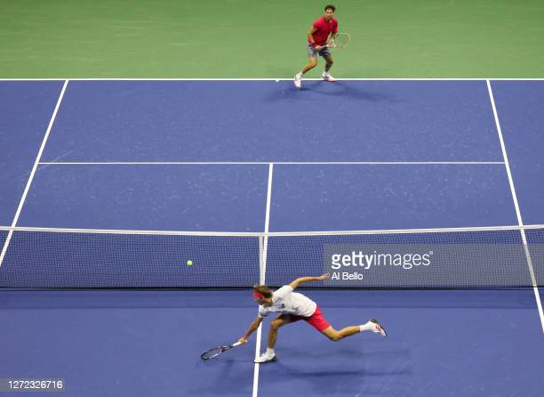 Alexander Zverev of Germany returns the ball in the fifth set during his Men's Singles final match against and Dominic Thiem of Austria on Day...