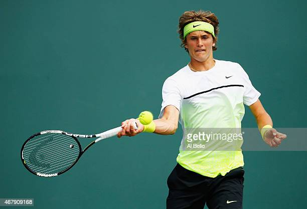 Alexander Zverev of Germany returns the ball to Lukas Rosol of the Czech Republic during day 6 of the Miami Open at Crandon Park Tennis Center on...