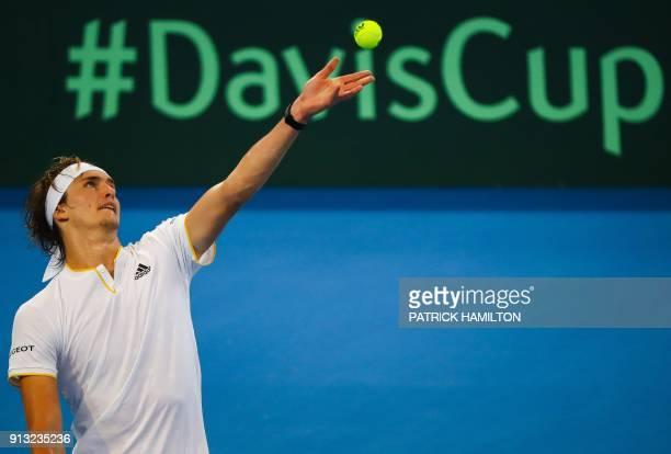 Alexander Zverev of Germany serves against Alex De Minaur of Australia during their men's singles tennis match in the Davis Cup World Group tie at...