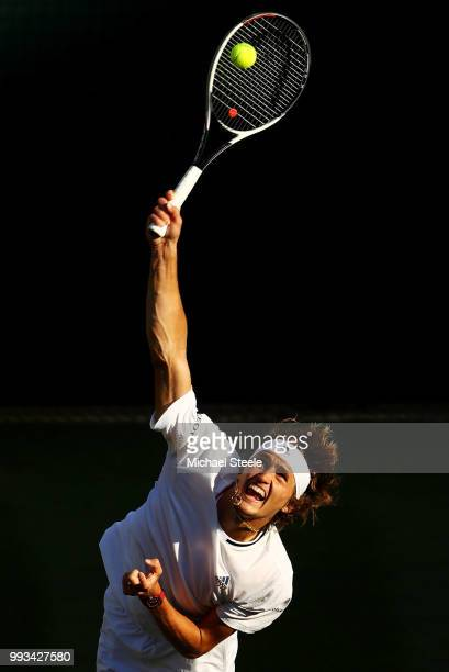 Alexander Zverev of Germany serves against Ernests Gulbis of Latvia during their Men's Singles third round match on day six of the Wimbledon Lawn...