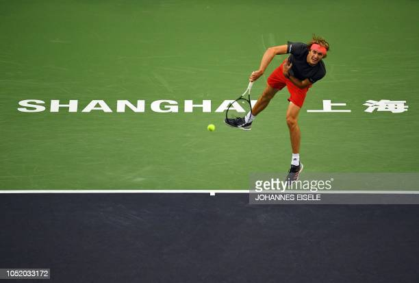 Alexander Zverev of Germany serves against Novak Djokovic of Serbia in their men's singles semifinal match at the Shanghai Masters tennis tournament...