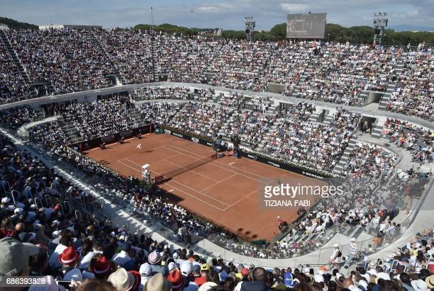 Alexander Zverev of Germany serves against Novak Djokovic of Serbia during the ATP Tennis Open final on May 21 2017 at the Foro Italico in Rome...