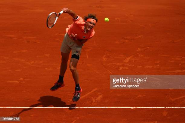 Alexander Zverev of Germany serves during the mens singles fourth round match against Karen Khachanov of Russia during day eight of the 2018 French...