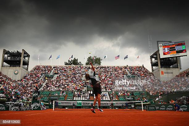 Alexander Zverev of Germany serves during the Men's Singles third round match against Dominic Thiem of Austria on day seven of the 2016 French Open...