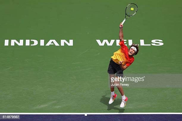 Alexander Zverev of Germany serves to Ivan Dodig of Croatia during day five of the BNP Paribas Open at Indian Wells Tennis Garden on March 11 2016 in...