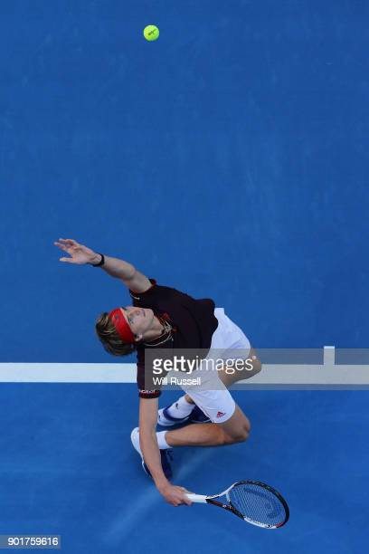 Alexander Zverev of Germany serves to Roger Federer of Switzerland in the mens singles match on Day Eight of the 2018 Hopman Cup at Perth Arena on...