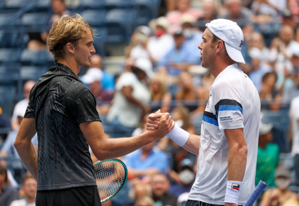 Alexander Zverev of Germany shakes hands after defeating Sam Querrey of the United States during his Men's Singles first round match on Day Two of...