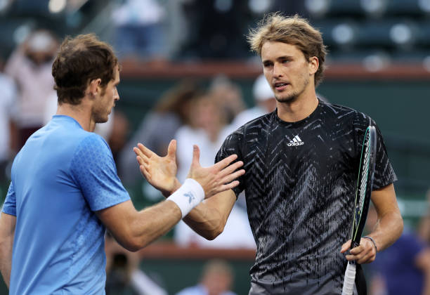 Alexander Zverev of Germany shakes hands at the net after his straight sets victory against Andy Murray of Great Britain during their third round...