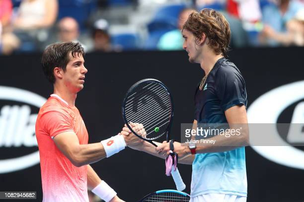 Alexander Zverev of Germany shakes hands with Aljaz Bedene of Slovenia following victory in the first round during day two of the 2019 Australian...