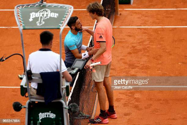 Alexander Zverev of Germany shakes hands with Damir Dzumhur of Bosnia and Herzegovina after his victory during Day Six of the 2018 French Open at...