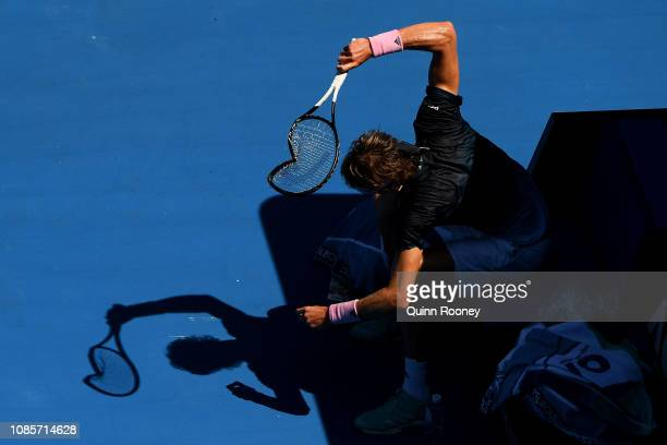 Alexander Zverev of Germany smashes his racquet in between games in his fourth round match against Milos Raonic of Canada during day eight of the...