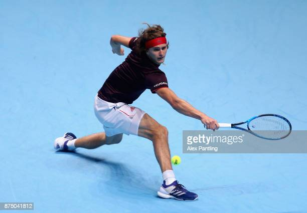 Alexander Zverev of Germany stretches to play a backhand during the singles match against Jack Sock of The United States on day five of the 2017...