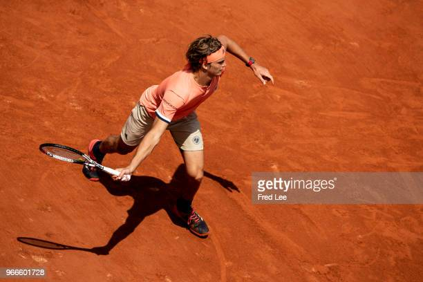 Alexander Zverev of Germany stretches to play a forehand during the mens singles fourth round match against Karen Khachanov of Russia during day...