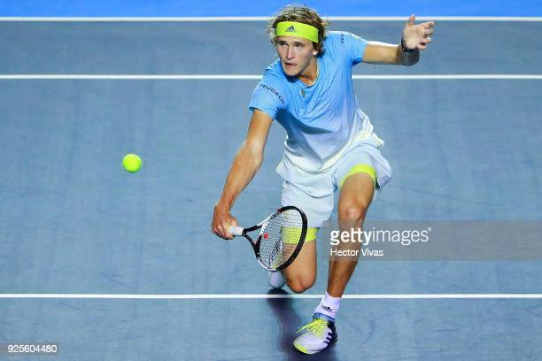 Alexander Zverev of Germany takes a backhand shot during a match between Steve Johnson of United States and Alexander Zverev of Germany as part of...
