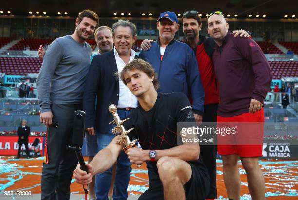 Alexander Zverev of Germany takes a selfie with his team and winners trophy after his straight sets victory against Dominic Thiem of Austria in the...