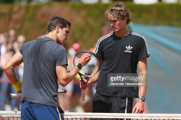 Alexander Zverev of Germany talks to his brother Mischa Zverev during a practice session on day 1 of the BMW Open by FWU at MTTC IPHITOS on April 28...