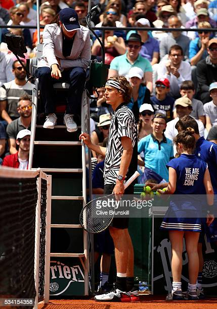 Alexander Zverev of Germany talks to the umpire during the Men's Singles first round match against PierreHughers Herbert of France on day four of the...