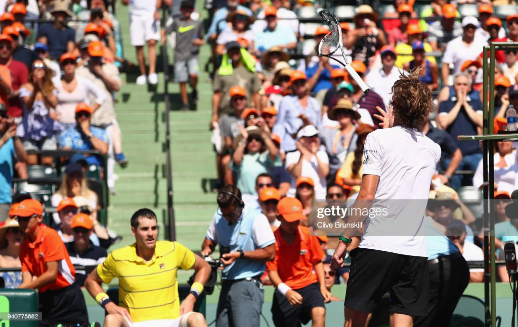 Alexander Zverev of Germany throws his racket to the crowd after smashing it upon his serve being broken in the third set against John Isner of the United States in the mens final during the Miami Open Presented by Itau at Crandon Park Tennis Center on April 1, 2018 in Key Biscayne, Florida.
