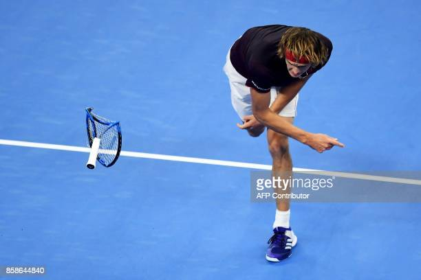TOPSHOT Alexander Zverev of Germany throws his racquet during his men's singles semifinal match against Nick Kyrgios of Australia at the China Open...