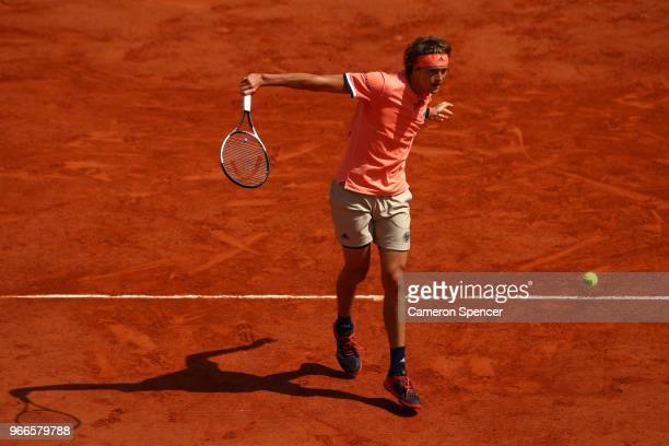Alexander Zverev of Germany volleys during the mens singles fourth round match against Karen Khachanov of Russia during day eight of the 2018 French...