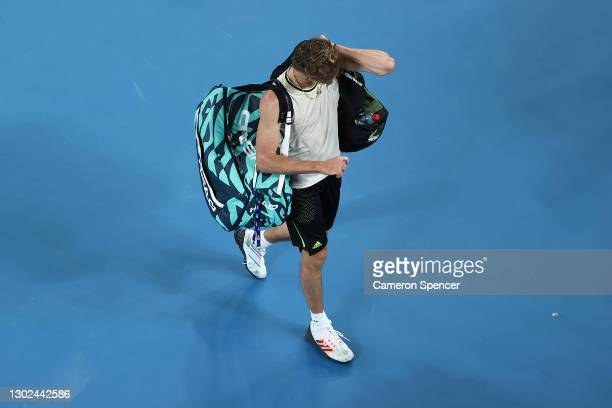 Alexander Zverev of Germany walks off the court after losing his Men's Singles Quarterfinals match against Novak Djokovic of Serbia during day nine...