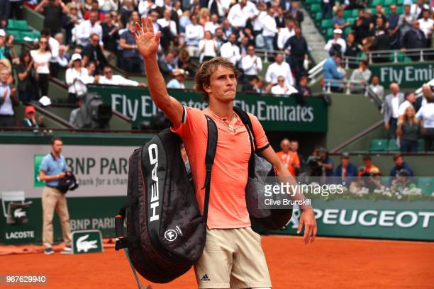 Alexander Zverev of Germany waves as he leaves the court following defeat during the mens singles quarter finals match against Dominic Thiem of...