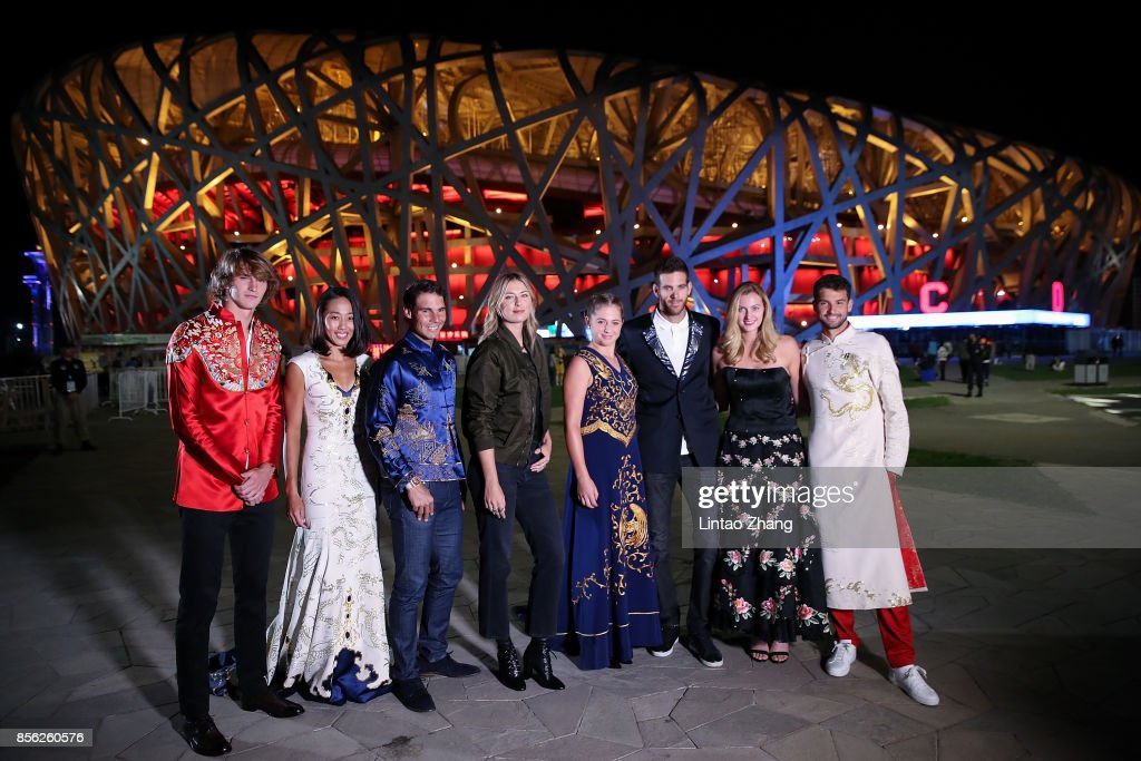 Alexander Zverev of Germany, Zhang Shuai of China, Rafael Nadal of Spain, Maria Sharapova of Russia, Jelena Ostapenko of Latvia; Martin Del Potro of Argentina, Petra Kvitova of Czech Republic and Grigor Dimitrov of Bulgaria poses for a picture front of the National Stadium before the 2017 China Open Player Party on October 1, 2017 in Beijing, China.