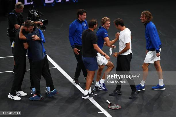 Alexander Zverev of Team Europe celebrates victory with teammate Roger Federer after the final match of the tournament during Day Three of the Laver...