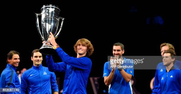 Alexander Zverev of Team Europe holds the trophy of the Laver Cup on September 24 2017 in Prague / AFP PHOTO / Michal Cizek