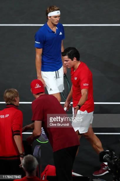 Alexander Zverev of Team Europe walks past Milos Raonic of Team World in the final match of the tournament during Day Three of the Laver Cup 2019 at...