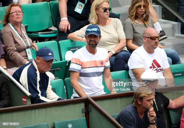 Alexander Zverev Sr father and coach of Alexander Zverev of Germany physio Hugo Gravil fitness coach Jez Green during Day Six of the 2018 French Open...