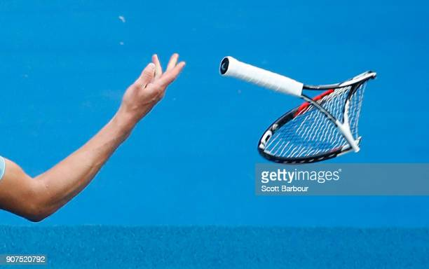 Alexander Zverev throws the racquet he smashed in frustration in the fifth set of his third round match against Hyeon Chung of Korea on day six of...