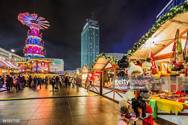 alexanderplatz christmas market, on the background the interhotel stadt berlin now park hotel - stadt stock pictures, royalty-free photos & images